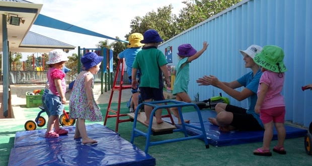 Strathalbyn child care play outside on mats